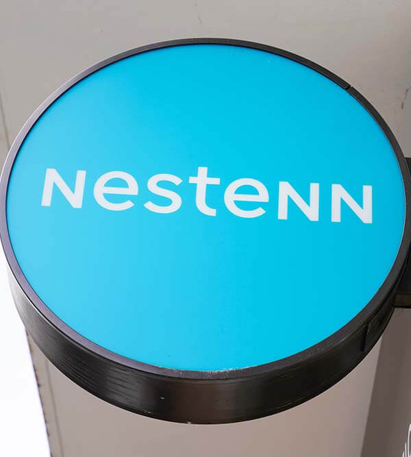 Bordeaux , Aquitaine / France - 09 24 2019 : sign store office Nestenn real estate french agency buying selling renting  search for  apartment house land