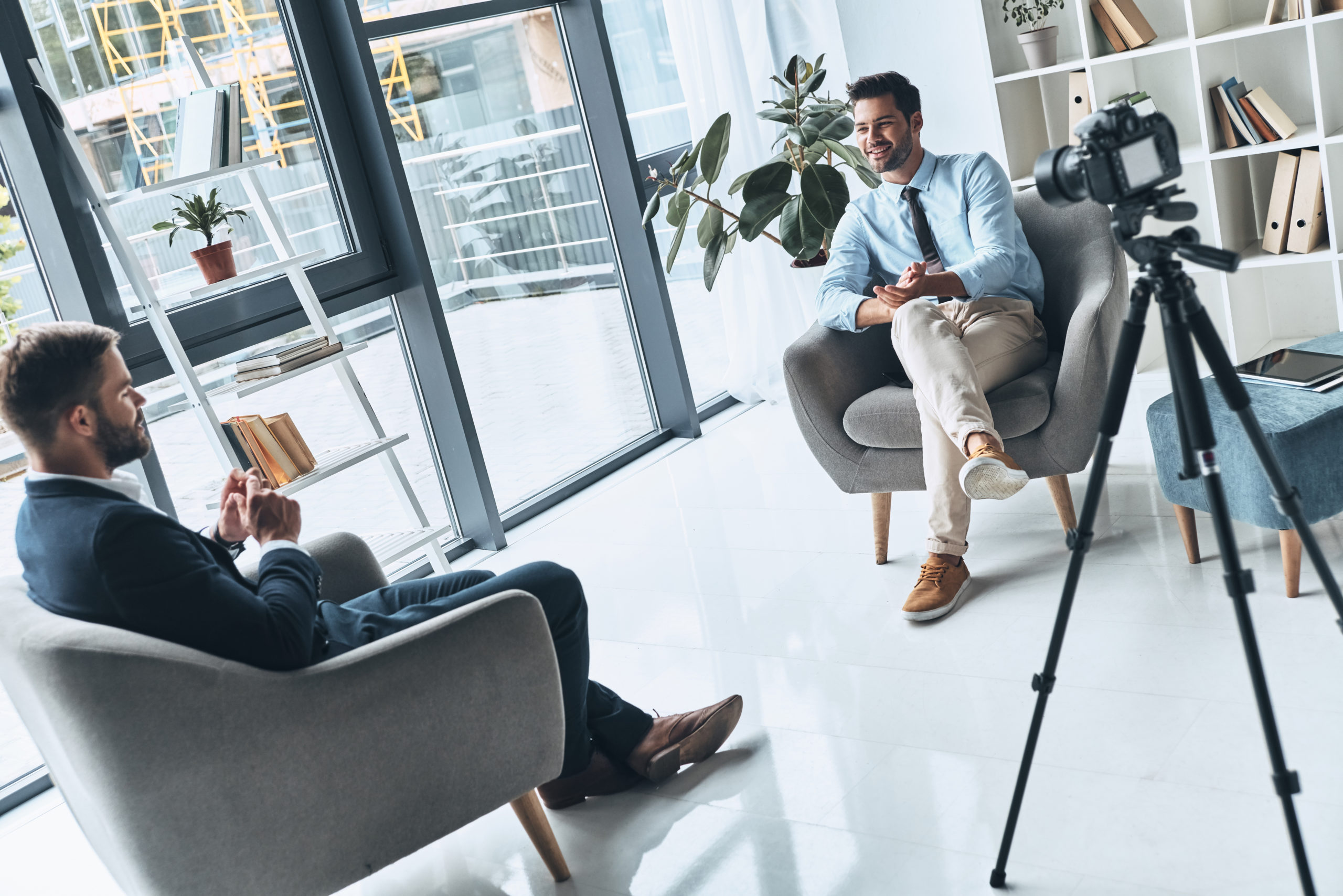 real estate video agent interviews local business owner